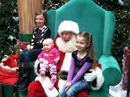 James' daughters posing with Santa: (L-R)  Maddy, Katy and Abby.