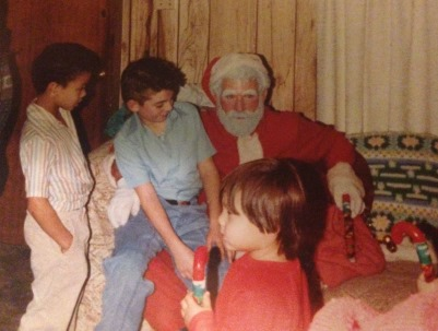 (L-R) Cousin Jon, James, and a family friend have fun with Santa.