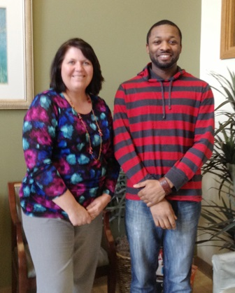 Alex poses for a photo with Seattle recruiter, Suzette Nedervelt.