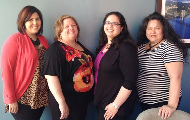Olivia poses with members of the Tacoma team (L-R: Tabitha, Barb, Olivia, and Teresa)