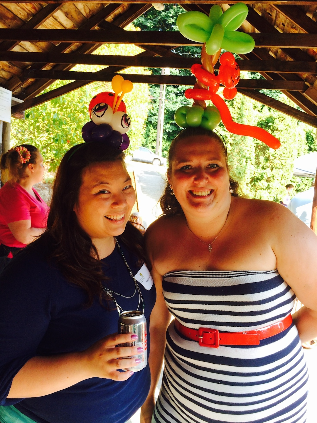 She doesn't always wear a palm tree with a monkey in her hair.  Just on casual days.  Here Alishia (R) is pictured with co-worker, Stephanie, at the TERRA family picnic--just one of many great events she helped plan and execute this quarter.