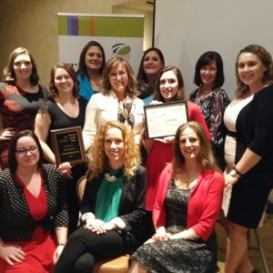 The award-winning Everett Team. (Back Row, L-R: Cary, Katie, Kirsten, and Patty. Middle, L-R: Brittaney, Sue, Santana, and Anne. Front Row, L-R: Kiara, Sarah and Cristal)