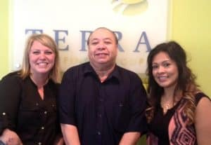 A happy Leo poses for a photo with Recruiter, Jean Reigel (L) and Staffing Specialist, Liliana Zamudio (R).