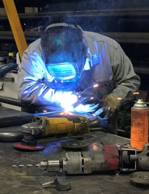 Image of Jim welding at his new job.