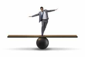 Manager on a seesaw trying to balance autonomy