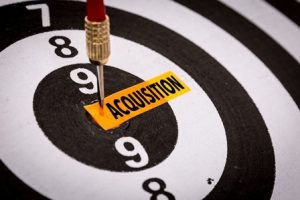 Talent Acquisition Image - Dart board with the word acquisition for bulls-eye.