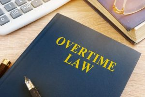 Overtime law written on an office notebook