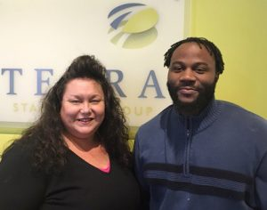 (L-R) Teresa with Michael Ford, Success Story whose new job offers him financial stability.