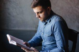 Man reading management book
