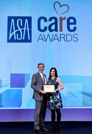 Image of Richard Wahlquist, President of the American Staffing Association, presenting award to JoAnn Xydis, TERRA's VP of Administration..