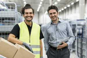 employee and manager smiling in a warehouse