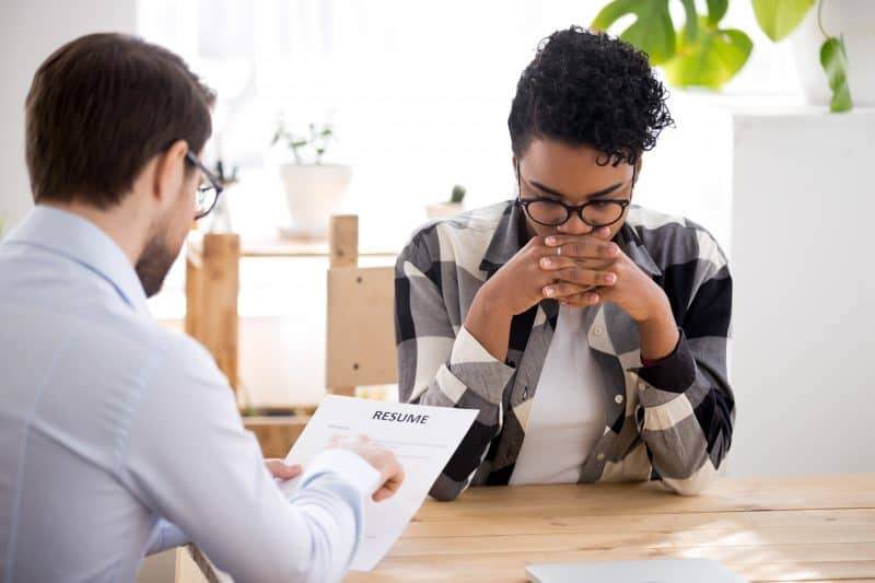 female job seeker stressed due to not researching an employer before her interview