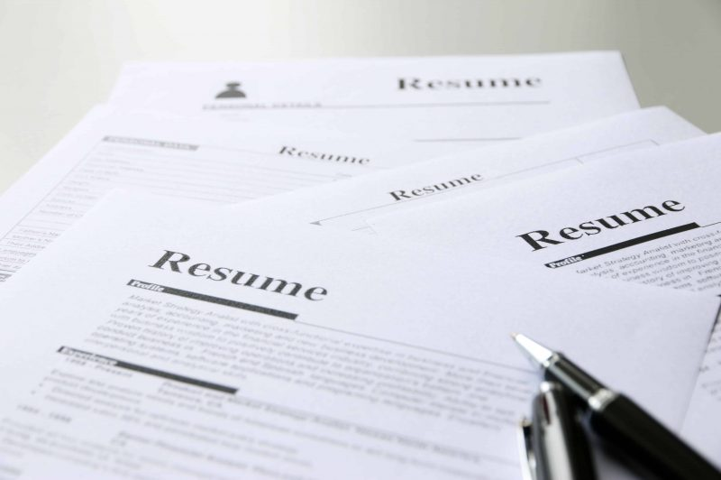 various resumes on a table - customize a resume