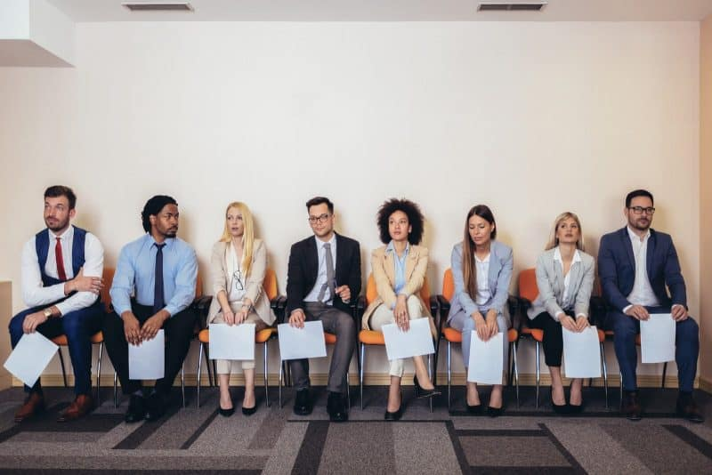 Photo of candidates waiting for a job interview. Selective focus