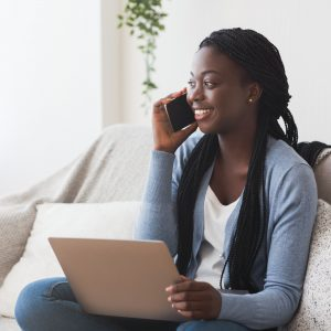 Young Woman Doing a Phone Interview at Home