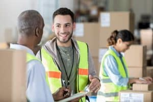 workers smiling in a warehouse