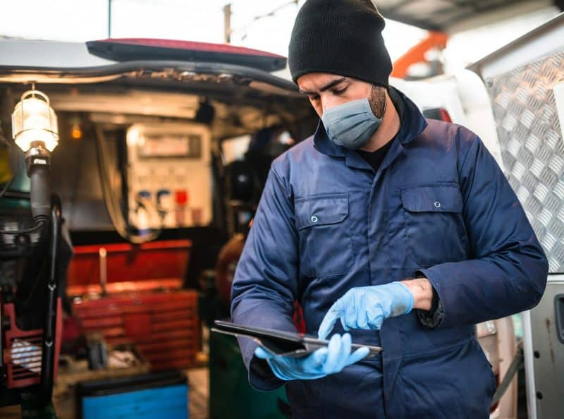 mechanic in front of the van with face mask