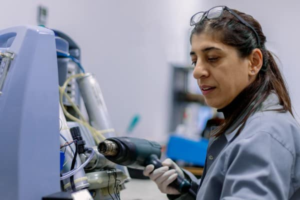 woman working on a medical device