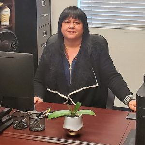 Image of Tina Fortier, TERRA Success Story, sitting at her desk at a job she loves