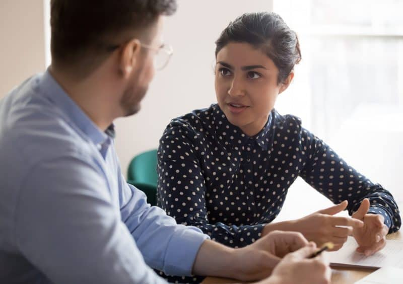 female employer creating a development plan with male employee