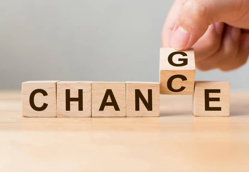 Person changing blocks from saying 'chance' to 'change'