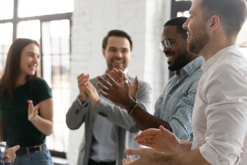 Group of coworkers celebrating as they excel at work